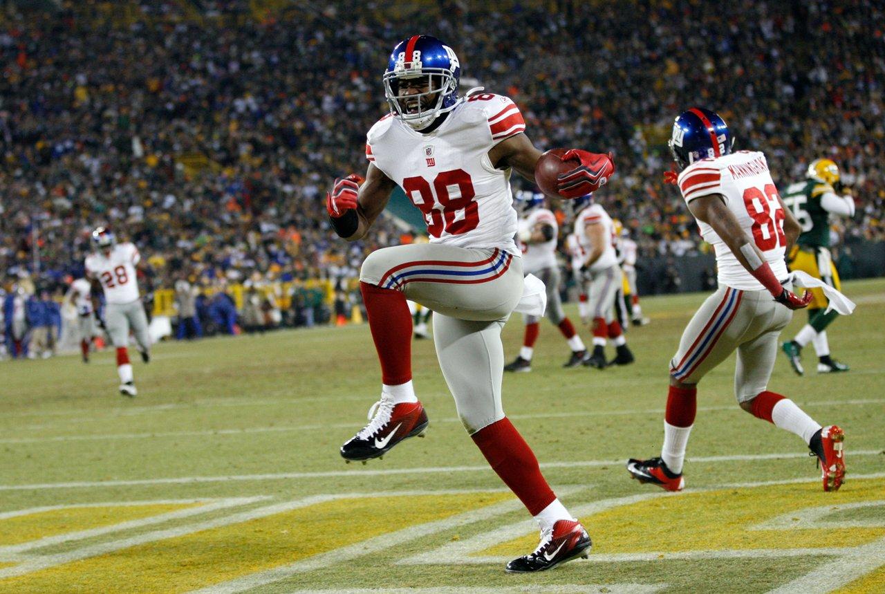 El wide receiver de los Gigantes de Nueva York Hakeem Nicks (88) festeja un touchdown en un partido divisional de los playoffs de la NFL, el domingo 15 de enero de 2012 en Green Bay, Wisconsin. (Foto AP/Mike Roemer)